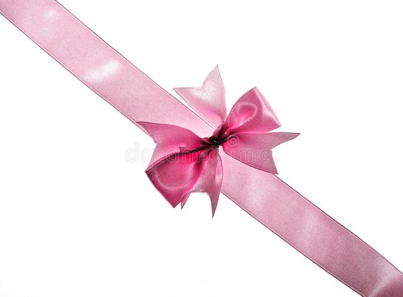Roze lint met boog stock afbeelding