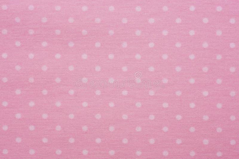 Roze materiaal met punten, een achtergrond stock fotografie