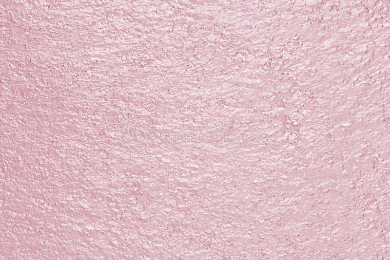 Roze nam achtergrond of de textuur van de goldtone de abstracte concrete muur toe stock foto's