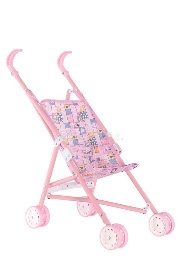 Roze poppenkinderwagen met wielen stock afbeelding