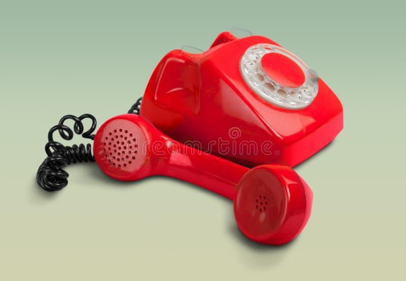Roze retro telefoon op abstracte achtergrond royalty-vrije stock foto's