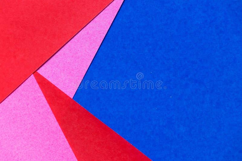 Roze, rode en blauwe kleurendocument vertoning als samenvatting backgrond stock foto's