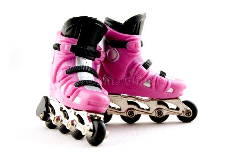 Roze rollerscates royalty-vrije stock foto