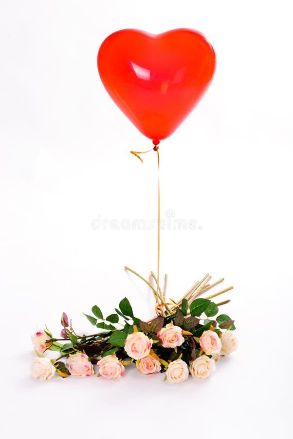 Roze rozen en ballon stock afbeelding