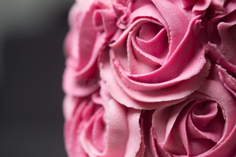Roze rozetcake stock afbeeldingen