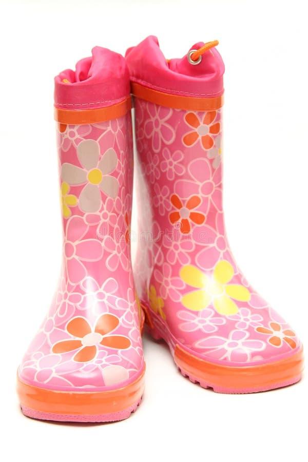 Roze rubberlaarzen stock foto