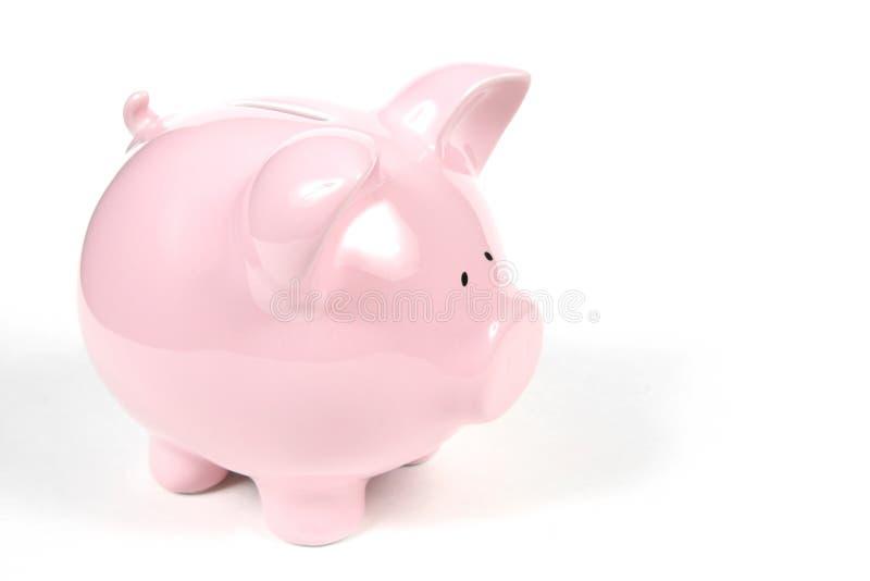 Roze Spaarvarken op witte achtergrond stock foto