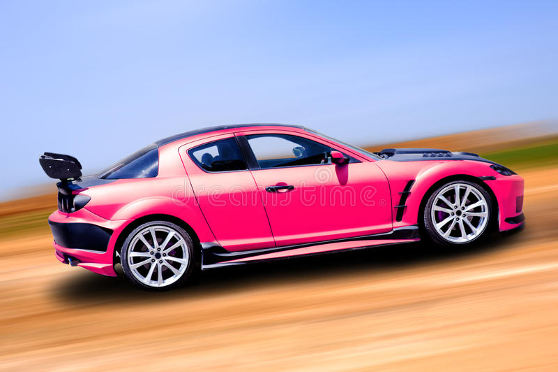 Roze sportwagen stock afbeelding