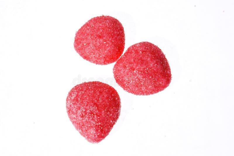 Roze suikergoed over witte achtergrond stock afbeeldingen