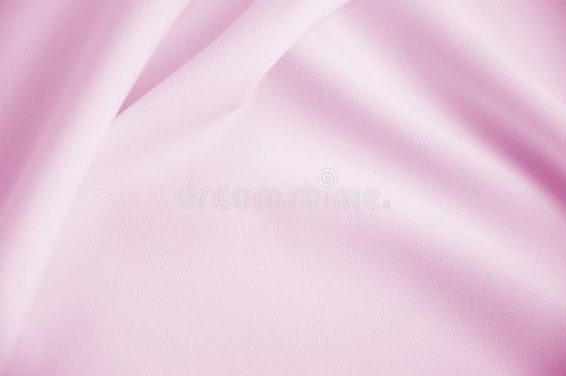 Roze vlotte satijnachtergrond royalty-vrije stock afbeeldingen