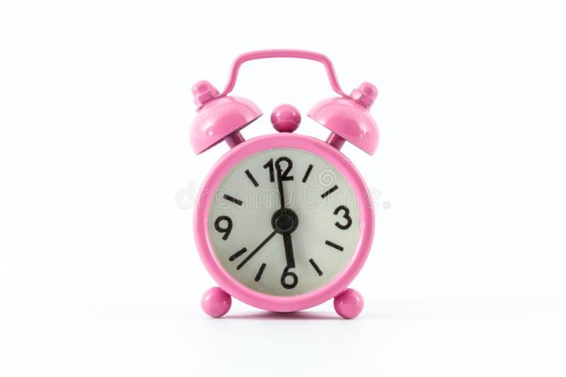 Roze wekker. stock afbeelding