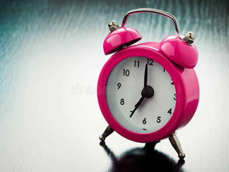 Roze wekker stock fotografie