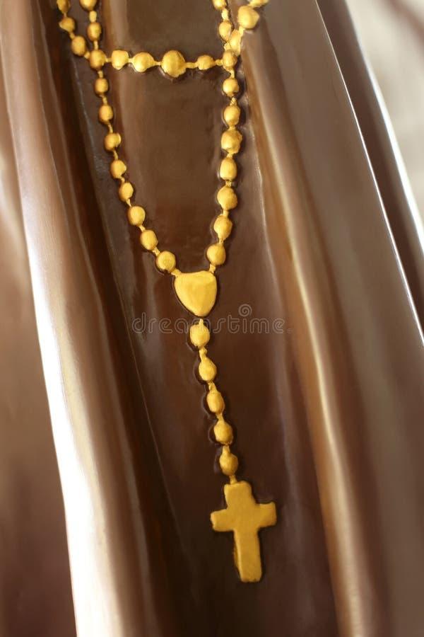 Rozentuinparels of kruisbeeld op standbeeld royalty-vrije stock afbeeldingen