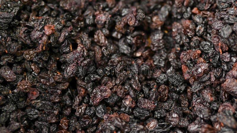 Rozijnen als textuur van de achtergronddruivenrozijn rozijnen in supermarkt royalty-vrije stock foto's