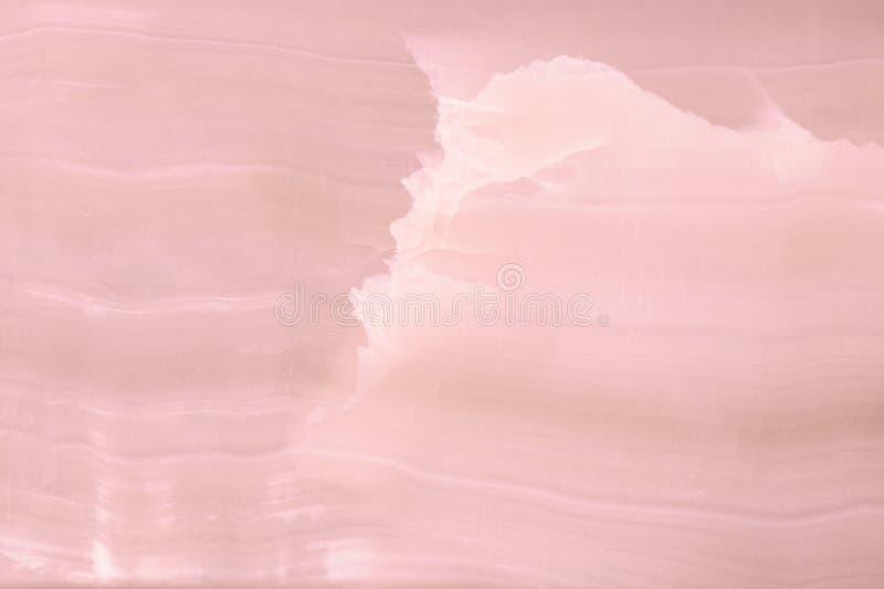 Rozjaśniający plasterka marmurowy onyks Horyzontalny wizerunek Ciepli menchia kolory Piękny zakończenie w górę tła obraz royalty free
