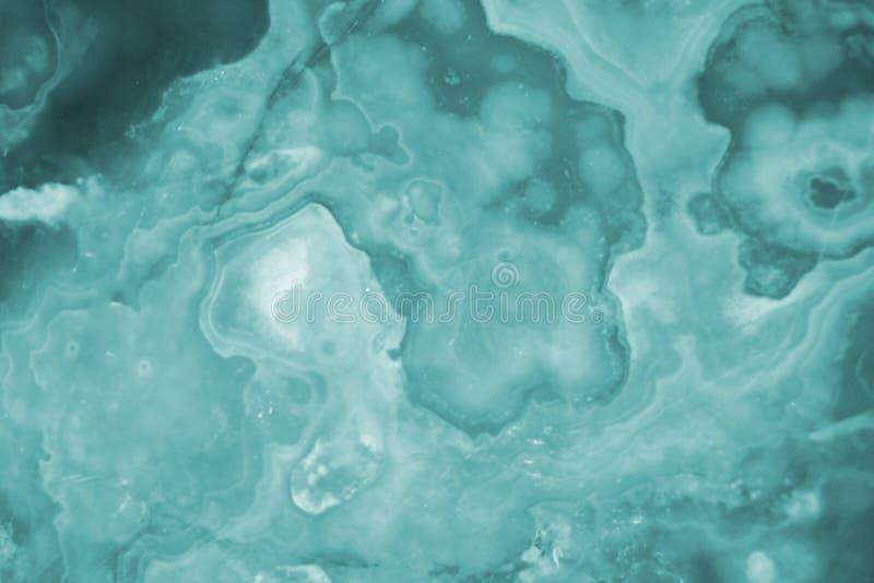Rozjaśniający turkusowych plasterków marmurowy onyks obrazy stock