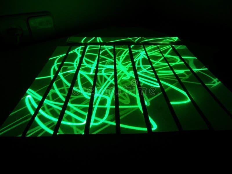 Rozjarzony laser obraz stock