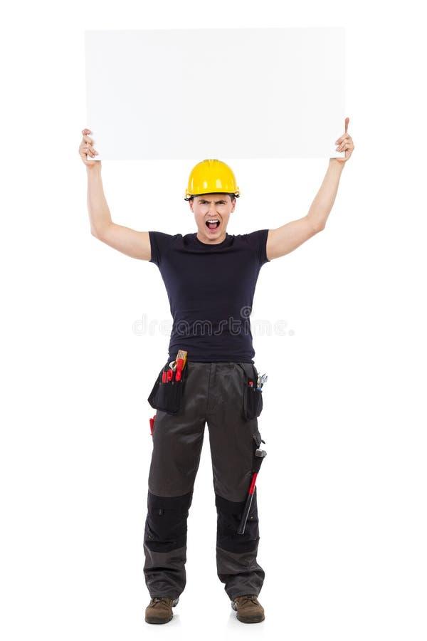 Rozkrzyczany ręcznego pracownika mienia baner abover jego głowa fotografia royalty free