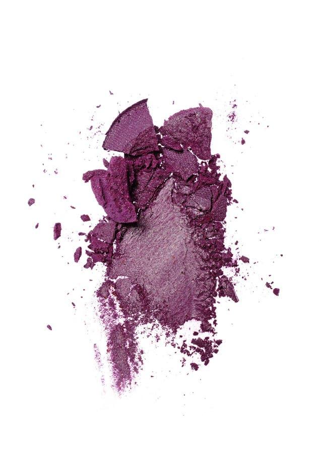 Rozmaz zdruzgotany purpurowy oko cień jak próbkę kosmetyczny produkt fotografia royalty free