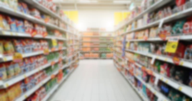Rozmyte zakupy półki w supermarkecie i domu towarowym Sho obraz royalty free