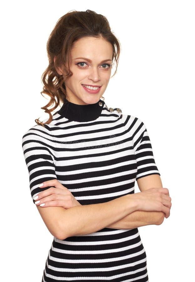 Rozochocona ładna kobieta z rękami składać odosobniony obraz stock