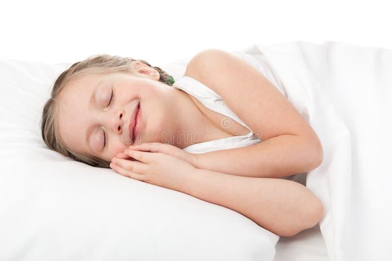 Rozochocona dziewczyna w białym łóżku fotografia royalty free