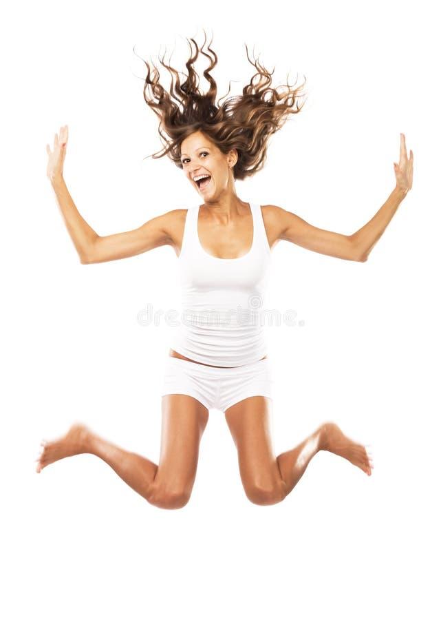 Rozochocona kobieta skacze zdjęcia stock
