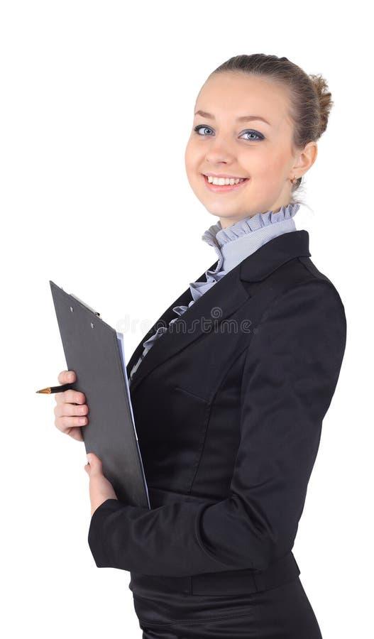 Rozochocona piękna biznesowa kobieta z schowka writing, isolat obraz royalty free