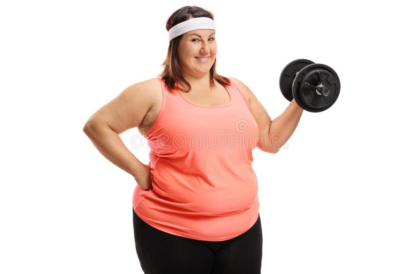 Rozochocona z nadwagą kobieta z dumbbell zdjęcie stock