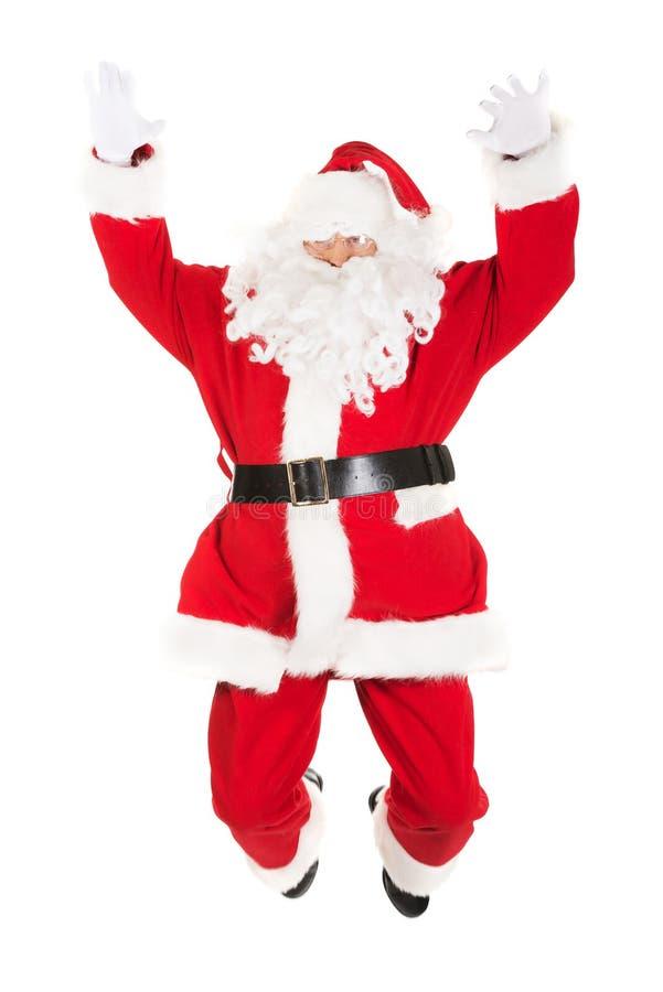 Rozochocony Święty Mikołaj doskakiwanie zdjęcie stock