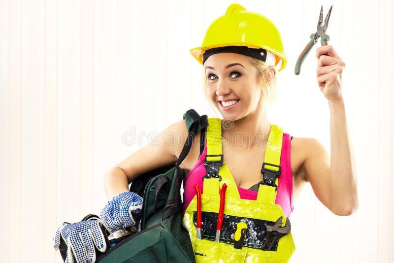 Rozochocony żeński pracownik budowlany fotografia royalty free