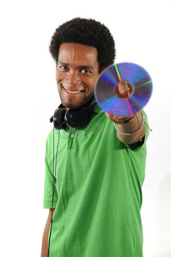 Rozochocony afrykański faceta mienia CD obrazy stock