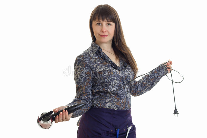 Rozochocony brunetki kobiety stylista z hairdryer w studiu fotografia stock
