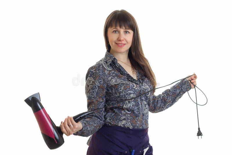 Rozochocony dorosłej kobiety stylista z hairdryer w rękach fotografia royalty free