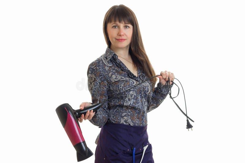 Rozochocony kobieta stylista z hairdryier w rękach zdjęcie royalty free