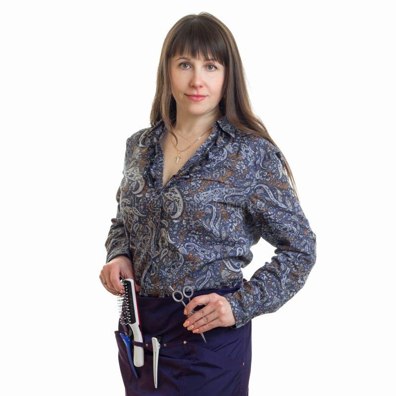 Rozochocony kobieta stylista z narzędziami w rękach zdjęcia stock