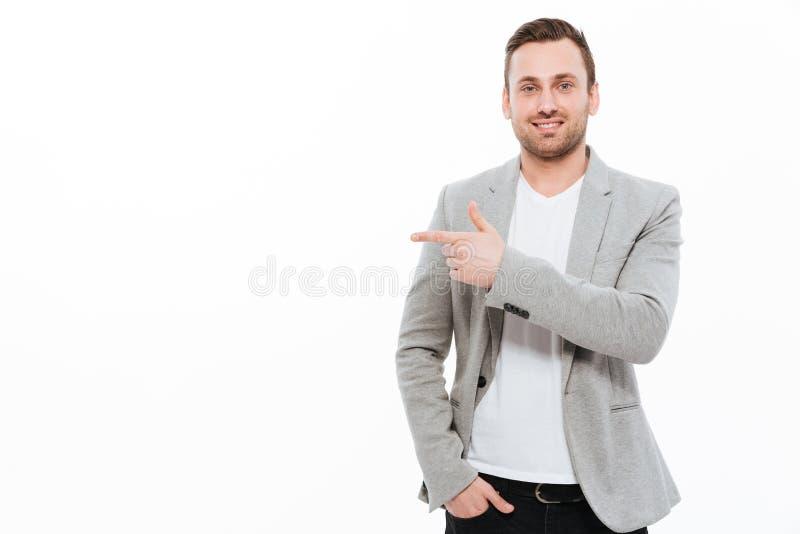 Rozochocony młody biznesmena wskazywać fotografia stock