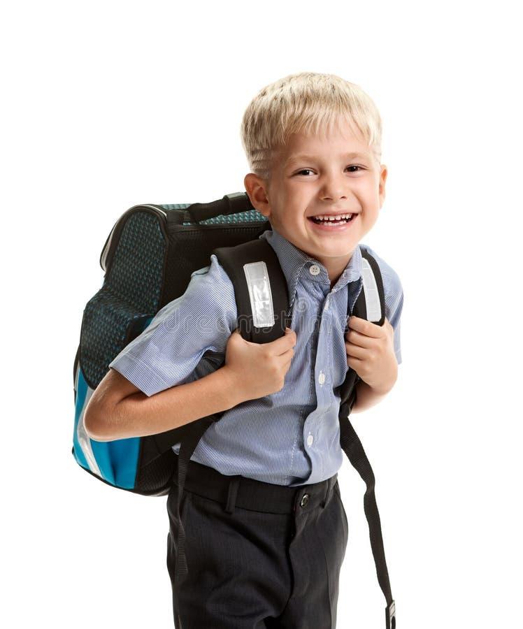 Rozochocony uczeń z plecakiem zdjęcia royalty free