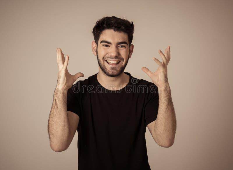 Rozochocony zdziwiony, szczęśliwy mężczyzna odświętności zwycięstwo i fotografia stock