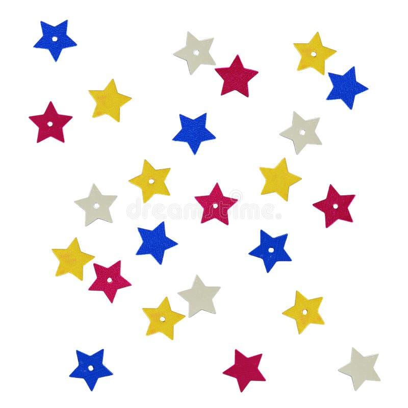 Rozrzuceni kolorowi gwiazdowi kształtów cekiny zdjęcia stock