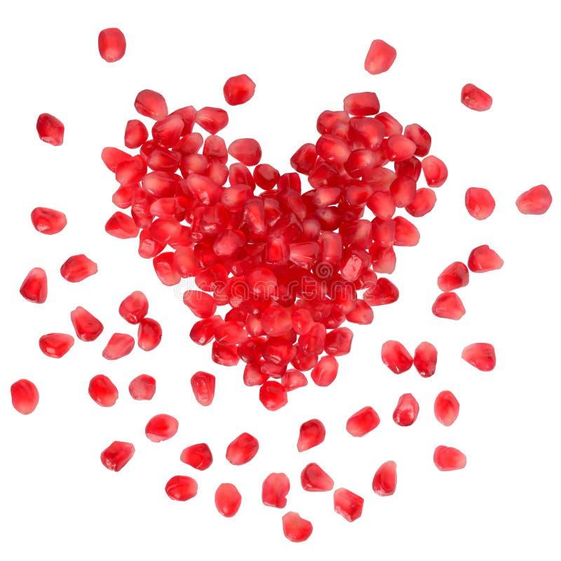 Rozrzucony zbożowy granatowiec w formie serca zdjęcie stock