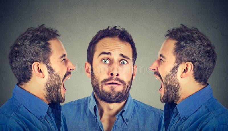Rozszczepiona osobowość Dwa gniewnego mężczyzna krzyczy przy okaleczający obrazy royalty free