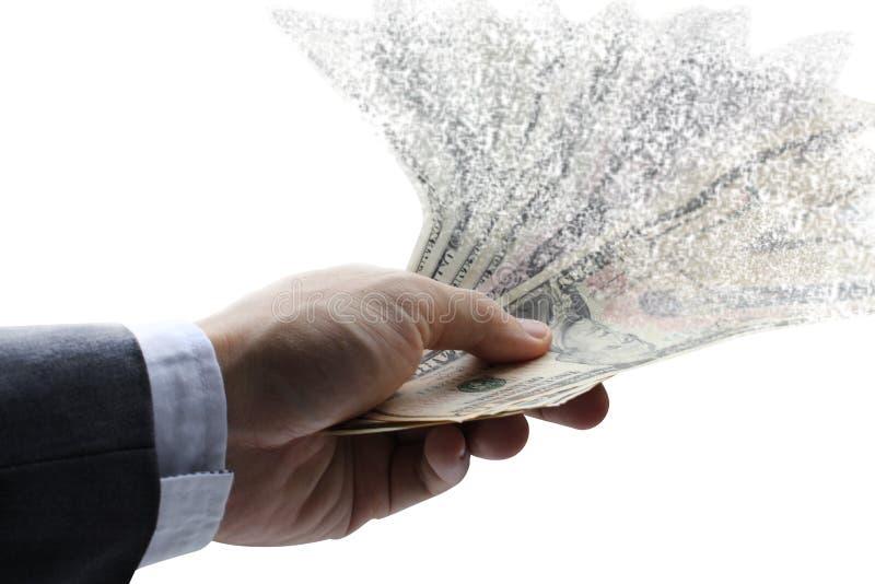 Rozszerzanie się dolarowa papierowa waluta w ręce zdjęcia stock