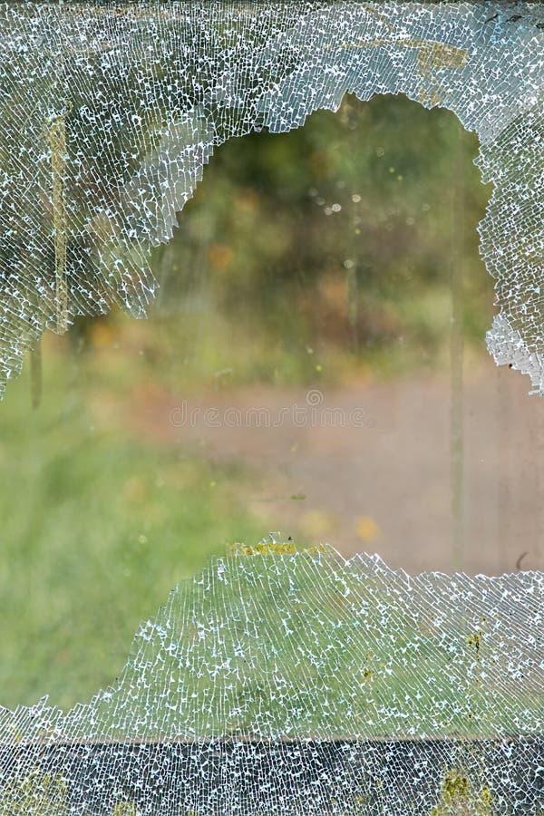 Roztrzaskująca tafla łamany nadokienny szkło Zbawczy szkło rozbijający v fotografia stock