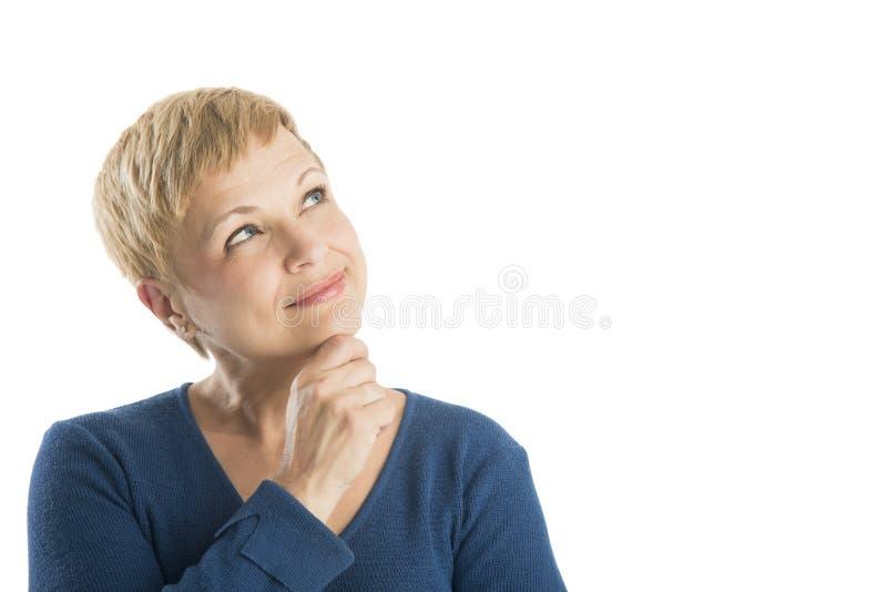 Rozważna kobieta Z ręką Na podbródka Przyglądający Up zdjęcia royalty free
