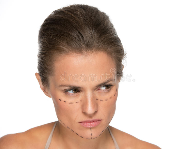 Rozważna młoda kobieta z chirurgii plastycznych ocenami obrazy royalty free
