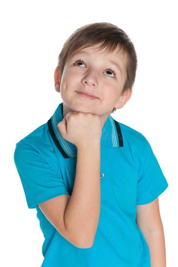 Rozważna uśmiechnięta chłopiec zdjęcie royalty free