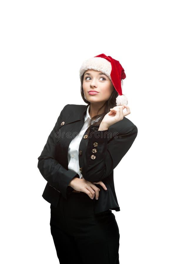 Rozważny bizneswoman w Santa kapeluszu na biel zdjęcia stock