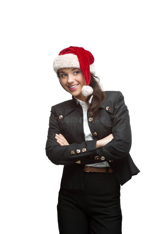 Rozważny bizneswoman w Santa kapeluszu na biel obrazy stock