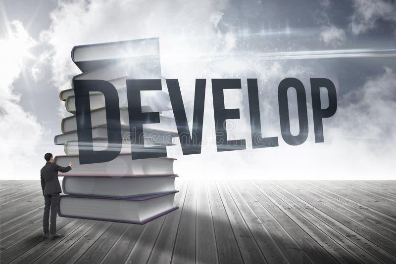 Rozwija przeciw stercie książki przeciw niebu zdjęcie stock